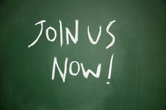 Join us now title. On blackboard Stock Image