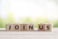 Join us sign on wooden cubes Stock Image