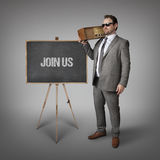 Join us text on blackboard with businessman Stock Photo