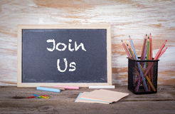 Join Us text on a blackboard Royalty Free Stock Photos