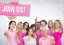 Join us Text and Hand holding card with pink breast cancer awareness women royalty free stock photo