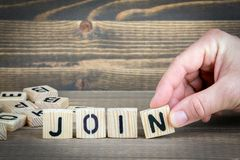 Join. Wooden letters on the office desk, informative and communication background.  Stock Image