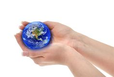 Joined female hands holding globe Royalty Free Stock Image