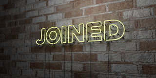JOINED - Glowing Neon Sign on stonework wall - 3D rendered royalty free stock illustration. Can be used for online banner ads and direct mailers Royalty Free Stock Photography