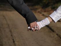 Joined hands couples Suite Royalty Free Stock Photos