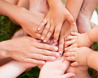 Joined hands. Family holding hands together closeup Royalty Free Stock Images