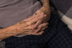 Joined hands of an old woman. Folded hands of a very old woman royalty free stock image