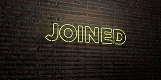JOINED -Realistic Neon Sign on Brick Wall background - 3D rendered royalty free stock image. Can be used for online banner ads and direct mailers Stock Photo