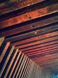 Joined wood. Interlocking wooden beams form the underside of a bridge royalty free stock photo