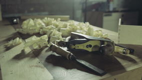 Joiner adds together two wooden workpieces slow motion stock footage