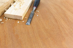 Joiner chisel with boards and shavings. Old carpenter wood chisel tool with boards and shavings stock photo