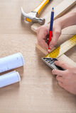 Joiner do scetch on wooden plank Royalty Free Stock Photo