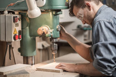Joiner Drilling Wooden Board Stock Photography