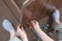 Joiner furniture assemblage at home using allen key, hexagonal w Royalty Free Stock Photos