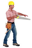 Joiner holding a saw Stock Photography