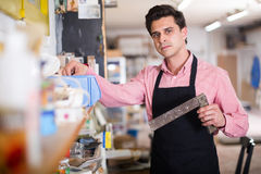Joiner looking for necessary tools Stock Photography