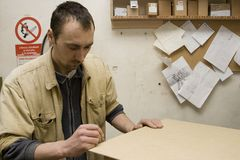 Joiner making furniture in his workshop Royalty Free Stock Images