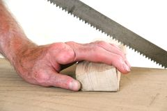 Joiner without one finger sawing a piece of wood Stock Images