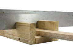 Joiner's accessories a saw and stuslo. Royalty Free Stock Photo