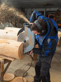 Joiner sawing wood with a chainsaw Royalty Free Stock Images