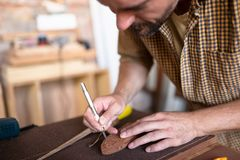 A joiner using his chisel. A delicate work of joiner. Carving from the wood using chisel stock photography