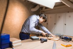 Joiner working and designing on workbench Stock Photos