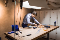 Joiner working and designing on workbench Stock Photography