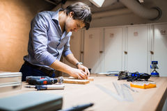 Joiner working and designing on workbench Stock Images