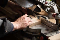 Joiner working on a machine with a circulation saw. Carpenter working on a machine with a circulation saw Stock Images