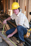Joiner working in new house Royalty Free Stock Photography