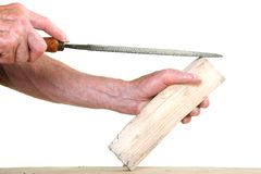 Joiner working on a piece of wood with a file Stock Photos