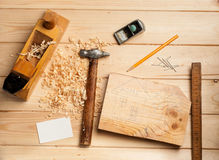 Joinery tools on wood table background with