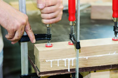 Joinery work. Gluing wood pieces Stock Image