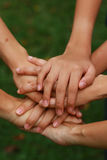 Joining hand together. Group of people joining hand together to show support and agreement Royalty Free Stock Photo