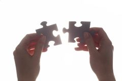 Joining two pieces of jigsaw puzzle. Solution, business. royalty free stock image