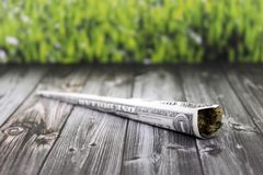 Joint bundled with a dollar bill royalty free stock photography