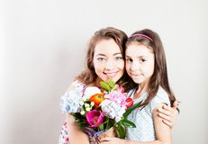 The joint celebration of mom and daughter royalty free stock image