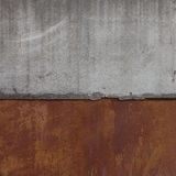 Joint of concrete slab with rusty metal wall. Textured grunge background Stock Image