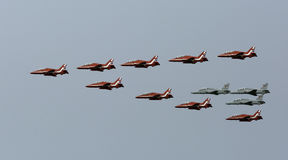 Joint flypast of British Red Arrows and Royal Bahrain Air Force Stock Photo