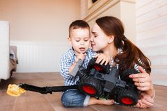 Mom and child are playing a toy car stock photography