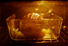 Joint of ham in oven Royalty Free Stock Photos