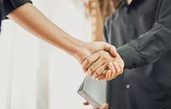 Joint Hands of Two Businessmen After Negotiating a Successful Business Agreement, And the handshake together. This is to promote cooperation in the joint Royalty Free Stock Photos