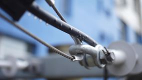 Joint hinge with a steel cable. Frame. The connection of metal staples, loops and steel ropes stock footage
