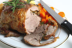 Joint of lamb with carving knife Royalty Free Stock Image