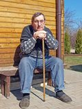 Joint pain. Country senior man with the joint pain royalty free stock image