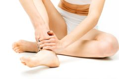 Joint pain, woman with leg injury, stretching Royalty Free Stock Photography