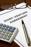 Joint-Venture Agreement. Image of a joint-venture agreement on an office table Stock Photography