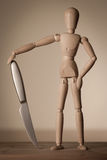 Jointed doll with a knife Royalty Free Stock Images
