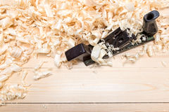 Jointer and softwood shavings on boards Stock Photos