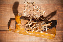 Jointer on wooden background Royalty Free Stock Photos
